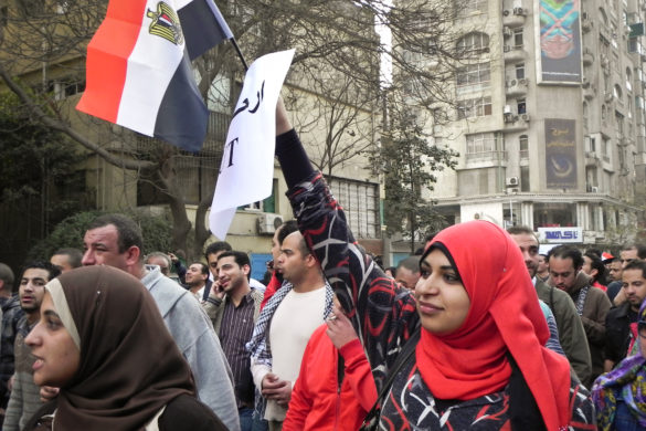 Woman marching from Mohandiseen into Tahrir Square on January 25, 2011. Photo taken by Sallie Pisch.