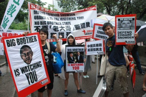 Protesters in Hong Kong show their support for Edward Snowden