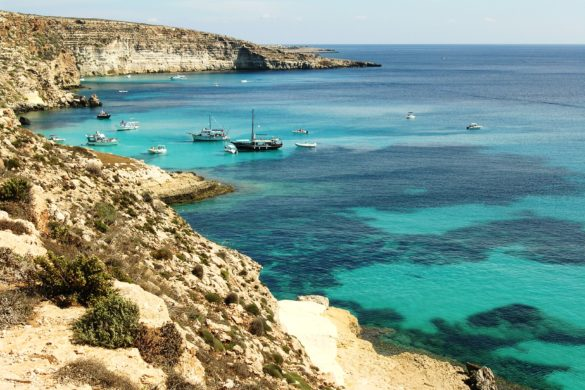 Boats off the shore of Lampedusa. Photo courtesy of Wikimedia Commons