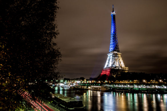 The Eiffel Tower lit in blue white red - Fluctuat nec Mergitur