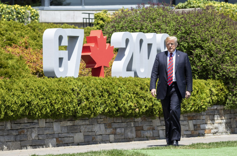 President Donald J. Trump arrives at the G-7 Official Welcome, Friday, June 8, 2018, and is greeted by Canadian Prime Minister Justin Trudeau and his wife Mrs. Sophie Gregoire Trudeau, at the Fairmont Le Manoir Richelieu, in Charlevoix, Canada.  (Official White House Photo by Shealah Craighead)