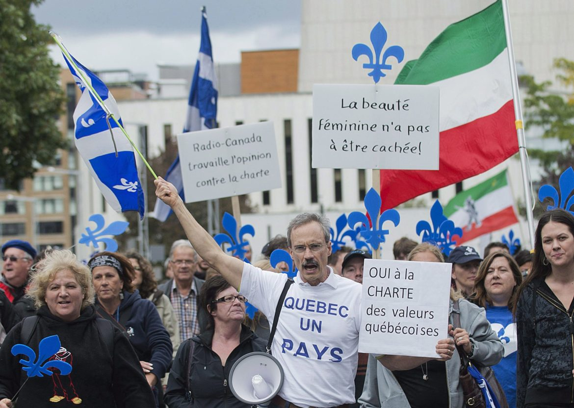 Supporters of a proposed Quebec values charter march in Montreal, Sunday, September 22, 2013, during a demonstration in favour of the charter which would ban the wearing of religious symbols and clothing from any publinc institutions if brought into law.THE CANADIAN PRESS/Graham Hughes
